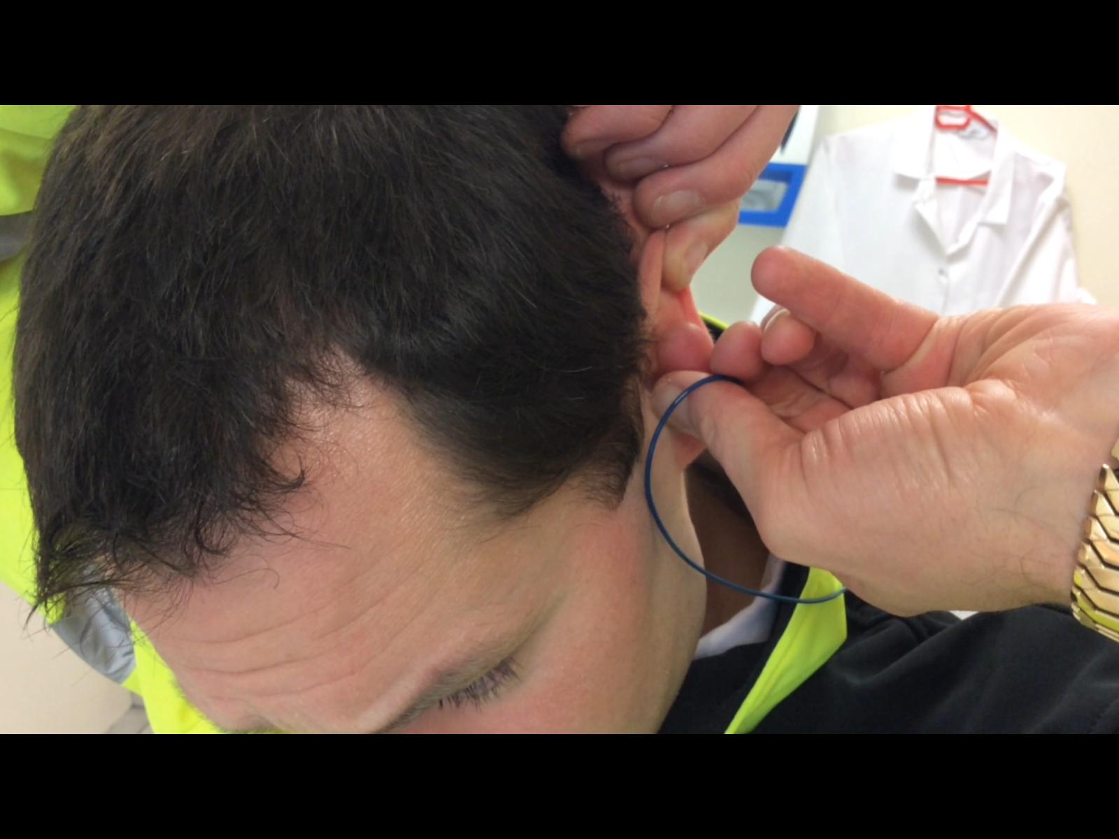 Man adjusting earplug fit