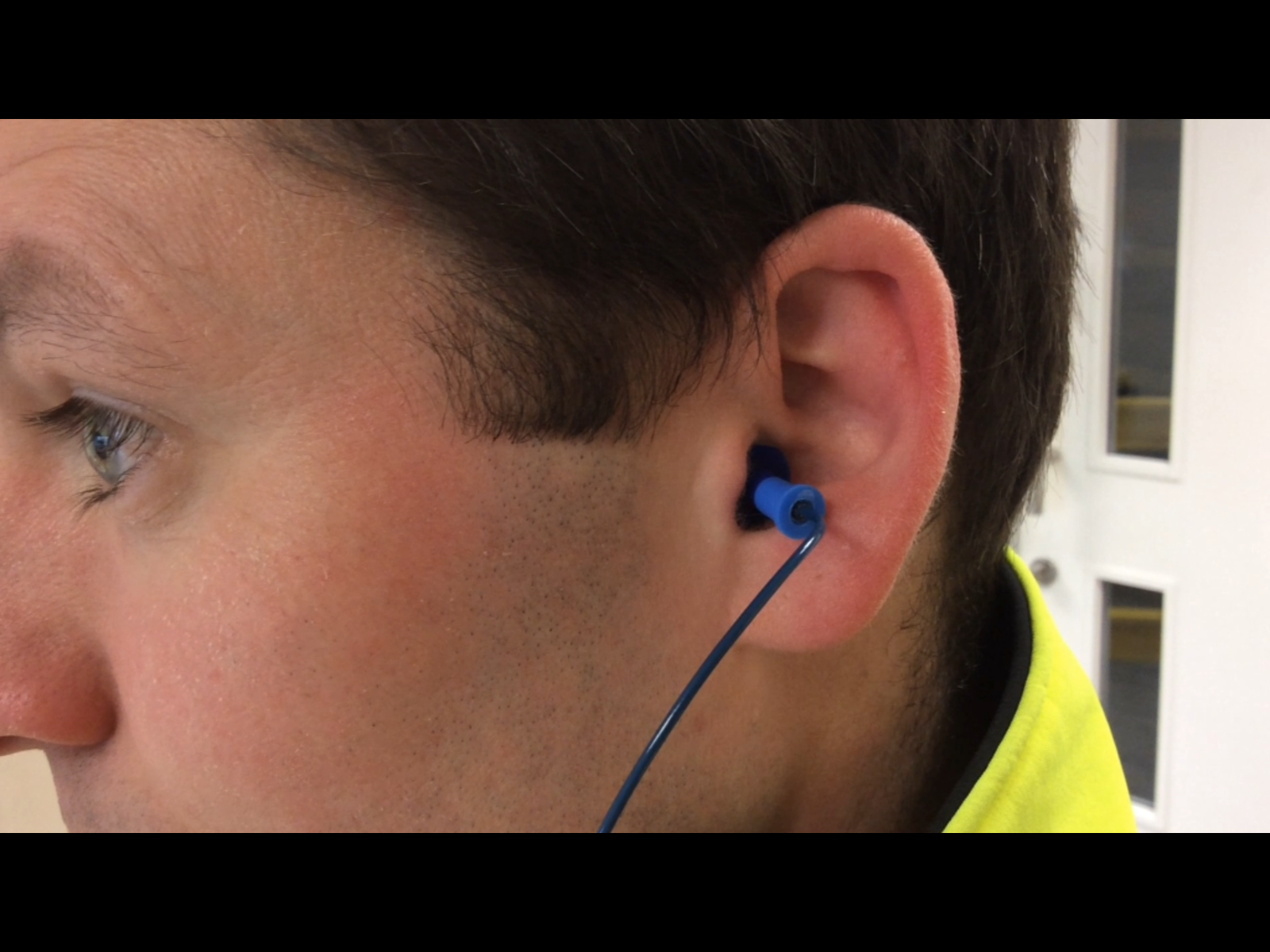 Man with earplug properly fitted